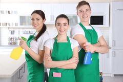 Cleaning service team working. In kitchen stock photography