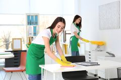 Cleaning service team working. In office Royalty Free Stock Photos