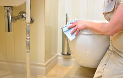 Cleaning service in the wc Royalty Free Stock Photos