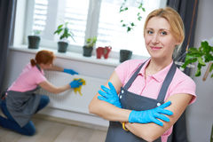 Cleaning service. Woman cleaner portrait. Cleaning service. Female staff worker cleaner portrait at interior home Royalty Free Stock Images
