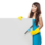 Cleaning service woman presenting blank board Royalty Free Stock Images