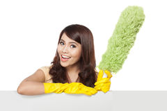 Cleaning service woman presenting blank board Royalty Free Stock Photo