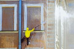 Cleaning service worker. Washing old building facade stock photography