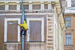 Cleaning service worker. Washing old building facade royalty free stock images