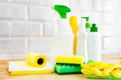 Cleaning set for different surfaces. Cleaning products or home cleaning concept. Cleaning set for different surfaces in kitchen, bathroom and other rooms on stock photos