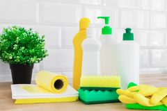 Cleaning set for different surfaces. Cleaning products or home cleaning concept. Cleaning set for different surfaces in kitchen, bathroom and other rooms on stock photo