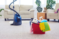 Cleaning set in front of vacuum cleaner Royalty Free Stock Photography