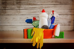 Cleaning set with products and supplies on kitchen table Stock Photos