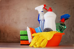 Cleaning set with products and supplies on kitchen table Royalty Free Stock Images