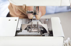 Cleaning sewing machine. Royalty Free Stock Images