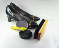 Cleaning shoes. Black ladies leather shoes and cleaning set Royalty Free Stock Photos