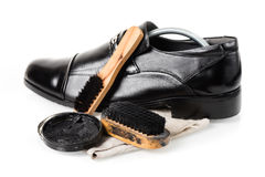 Cleaning shoes Royalty Free Stock Photo