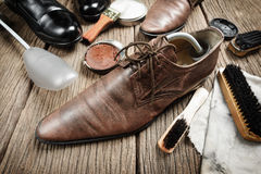 Cleaning shoes Stock Image