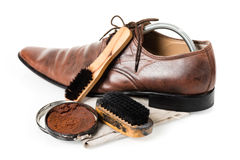 Cleaning shoes Stock Photography