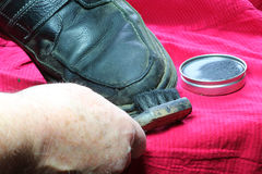 Cleaning shoes. Stock Image