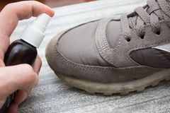 Cleaning shoes,washing the dirty sneakers , cleaning the shoes. Cleaning shoes,washing the dirty sneakers at home, cleaning the shoes Royalty Free Stock Photos