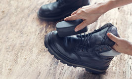 Cleaning shoes on wooden background Royalty Free Stock Photos