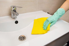 Cleaning sink of the bathroom Stock Images