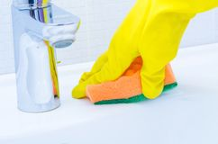 Cleaning sink and faucet with Stock Image