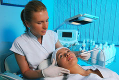 Cleaning skin. Young woman getting skin cleaning at beauty salon Stock Image