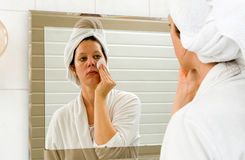 Cleaning skin in bathroom Stock Photo