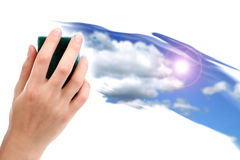 Cleaning the sky. A hand cleaning an image of the sky