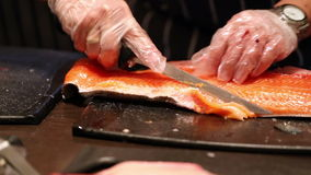Cleaning and slicing fish stock video