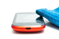 Cleaning the smart phone Royalty Free Stock Photo