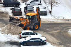 Cleaning of snow from city streets by means of special equipment Royalty Free Stock Photography