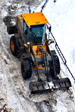 Cleaning of snow from city streets by means of special equipment Stock Photo