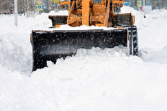 Cleaning snow drifts. Stock Photos