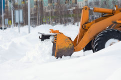 Cleaning snow drifts. Stock Images
