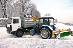 Cleaning and snow loading Stock Images