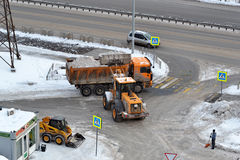 Cleaning of snow by means of special equipment. Royalty Free Stock Photo