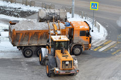 Cleaning of snow by means of special equipment. Royalty Free Stock Images