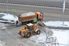 Cleaning of snow by means of special equipment. Stock Photos