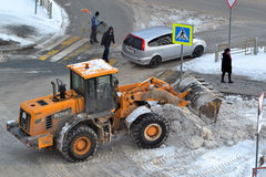 Cleaning of snow by means of special equipment. Royalty Free Stock Image