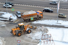 Cleaning of snow by means of special equipment. Royalty Free Stock Photos