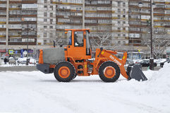 Cleaning of snow by means of special equipment. Stock Photo