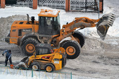 Cleaning of snow by means of special equipment. Royalty Free Stock Photography
