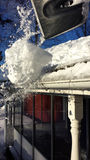Cleaning snow from roof Royalty Free Stock Photos
