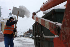 Cleaning of the snow on the street. Russia. Tomsk. Worker cleans of the snow on the street Royalty Free Stock Photo