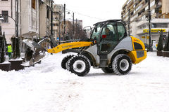 Cleaning the snow from the street Royalty Free Stock Images