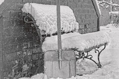 Cleaning snow in the yard in winter, black-and-white Stock Image
