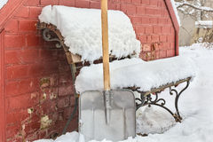 Cleaning snow in the yard in winter Stock Image
