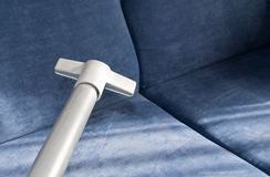 Cleaning sofa Royalty Free Stock Image