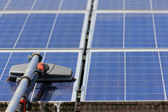 Cleaning Solar Panels Royalty Free Stock Image