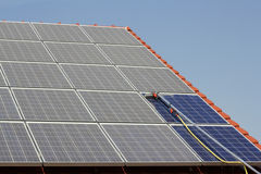 Cleaning Solar Panels Royalty Free Stock Photography
