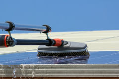 Cleaning solar panels royalty free stock photo