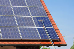 Cleaning solar panels stock photos